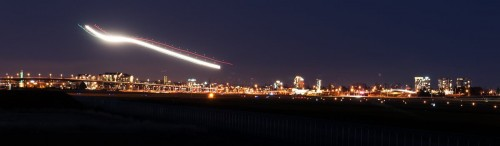 Vancouver airport airplane light trails