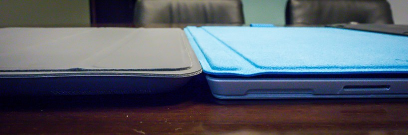 Microsoft Surface Pro 3 with Type Cover and iPad 4 with Apple Case side-by-side